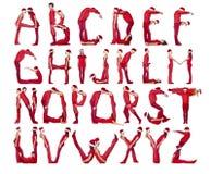 Het alfabet dat door mensen wordt gevormd. Stock Foto