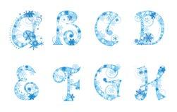 Het alfabet van Kerstmis met sneeuwvlokken Stock Foto's
