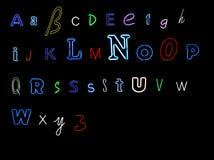 Het alfabetbrieven van het neon Stock Foto's