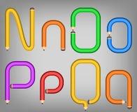 Het alfabetstijl van het kleurenpotlood Stock Foto's