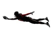 Het Amerikaanse silhouet van de voetbalster noterende touchdown Royalty-vrije Stock Fotografie