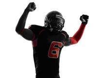 Het Amerikaanse silhouet van het voetbalsterwapens opgeheven portret Stock Fotografie