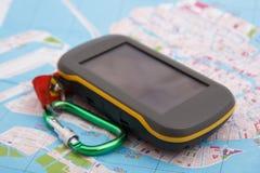 Het apparaat en de kaart van GPS stock afbeeldingen