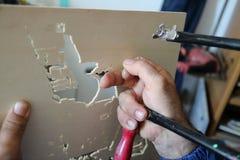 Het artisanaal werk met figuurzaag stock afbeeldingen
