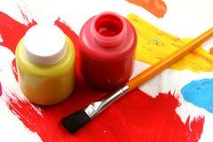 Het artistieke uitdrukking-rood van jonge geitjes en geel Royalty-vrije Stock Afbeeldingen