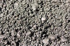 Het asfalt is donker Het macro ontspruiten Foto voor uw ontwerp royalty-vrije stock afbeelding
