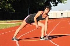 Het atletische vrouw uitrekken zich Royalty-vrije Stock Afbeelding