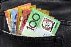 Het Australische geld in jeans steunt zak Stock Afbeeldingen
