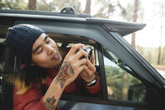 Het Aziatische Concept van Fotograaftaking pictures outdoors stock fotografie