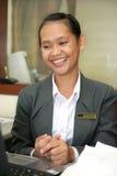 Het Aziatische glimlachen op het werk Royalty-vrije Stock Afbeelding
