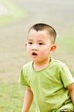 Het Aziatische jongen spelen Royalty-vrije Stock Foto's