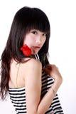 Het Aziatische meisje houdt toenam Stock Foto