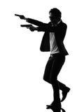 Het Aziatische silhouet van de gewapende manmoordenaar Stock Afbeeldingen