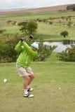 Het backswing van de golfspeler Stock Afbeeldingen