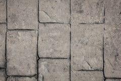 Het baksteenwegdek kan als achtergrondpatroon of textuur gebruiken stock foto