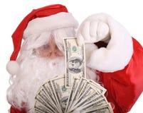 Het bankbiljet van de de holdingsdollar van de Kerstman. Royalty-vrije Stock Fotografie