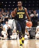 Het basketbalspeler #10 Tim Hardaway Jr van Michigan. Royalty-vrije Stock Afbeelding