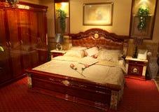 Het bed van de slaapkamer Royalty-vrije Stock Afbeeldingen