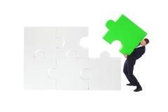 Het bedrijfsmens assembleren raadsel Royalty-vrije Stock Afbeelding