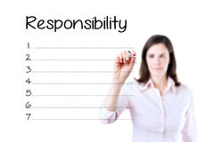 Het bedrijfsvrouw schrijven verantwoordelijkheidslijst in spatie Geïsoleerd op wit royalty-vrije stock afbeeldingen