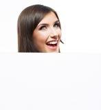 Het bedrijfsvrouwengezicht kijkt uit reclameaanplakbord Royalty-vrije Stock Afbeeldingen