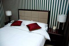 Het bedruimte van het hotel stock foto