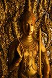 Het beeld van Boedha op de muur Royalty-vrije Stock Foto's