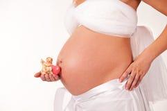 Het beeld van een zwangere vrouw. Stock Foto's