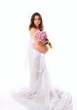 Het beeld van een zwangere vrouw met violette bloemen. Royalty-vrije Stock Fotografie