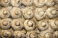 Het beeldhouwen van pleister geweven spiraalvormige achtergrond Stock Afbeelding
