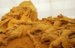 Het beeldhouwwerk van het zand van ridderlijke slag Stock Foto