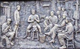 Het beeldhouwwerk van het leven in de oude maatschappij van het chongqing, China stock foto's