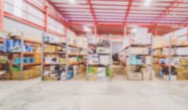 Het beeldonduidelijke beeld van het pakhuis en de goederen en gebruik over busi stock foto's