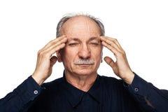 Het bejaarde lijdt aan hoofdpijn royalty-vrije stock foto's