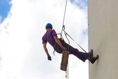 Het beklimmen op de muurwolkenkrabbers stock foto's