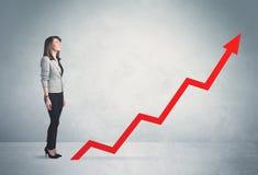 Het beklimmen op rode grafiekpijl royalty-vrije stock foto