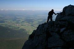 Het beklimmen van de berg Stock Afbeeldingen