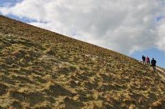 Het beklimmen van de heuvel royalty-vrije stock afbeeldingen