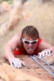 Het beklimmen van de mens Stock Foto