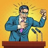 Het beleidskandidaat van de verkiezingscampagne bij het podium Stock Foto's