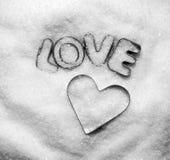 Het bericht en het hart van de liefde in suiker Stock Afbeeldingen