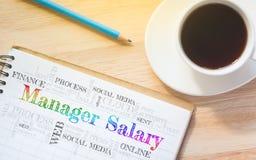 Het bericht van Salary van de conceptenmanager op boek Stock Afbeeldingen