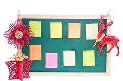 Het berichtraad van Kerstmis met ornamenten over wit Stock Afbeelding