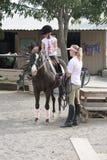 Het berijden van het meisje paard Stock Foto