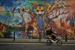 Het beroemde graffitiwerk aangaande de straten van Londen, Engeland Royalty-vrije Stock Foto's