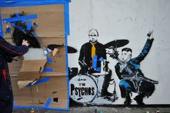 Het beroemde graffitiwerk aangaande de straten van Londen, Engeland Stock Foto's