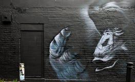 Het beroemde graffitiwerk aangaande de straten van Oost-Londen, Engeland Royalty-vrije Stock Afbeelding