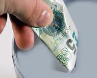 Het besparen van één pond Sterling Royalty-vrije Stock Afbeeldingen