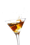 Het bespatten in een cocktailglas Royalty-vrije Stock Afbeeldingen
