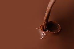 Het bespatten van chocolade Stock Afbeeldingen
